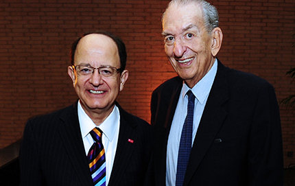 "During a recent symposium honoring USC Distinguished Professor of Chemistry George Olah of USC Dornsife (right) and the Loker Hydrocarbon Research Institute, USC President C. L. Max Nikias praises Olah as ""USC's golden treasure."" Photo by Rich Schmitt."