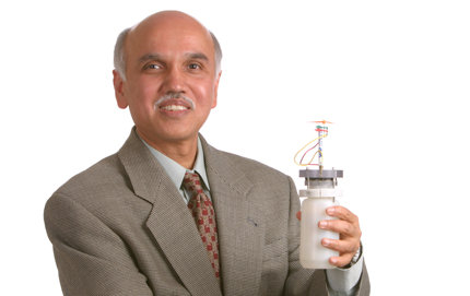 G.K. Prakash, Professor and George A. and Judith A. Olah Nobel Laureate Chair in Hydrocarbon Chemistry in USC Dornsife, who has spent decades researching flourine reagents is also working on a methanol economy concept. Here, he holds up a methanol fuel cell, which is powering a fan. Photo by Philip Channing.