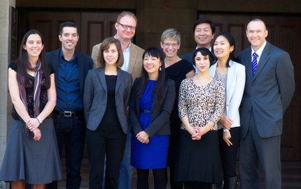 From left, Lauren Jennings, Bryan Roberts, Julianne Werlin, Bradford Bouley, Julia Lee, USC Provost Elizabeth Garrett, Anastasia Kayiatos, Gaoheng Zhang, Anri Yasuda and Associate Provost Mark Todd. Photo by Dietmar Quistorf.