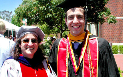 The experience students will have in the new molecular genetics and biochemistry progressive degree program is similar to a first year Ph.D. program, said USC Dornsife's Susan Forsburg. Here Forsburg stands with Michael Getz at his commencement, whom she mentored in her laboratory. Photo courtesy of Susan Forsburg.