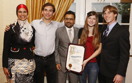 Student honorees from the Interfaith Badge Program stand with Varun Soni (center), dean of the USC Office of Religious Life. Photo by Steve Cohn.