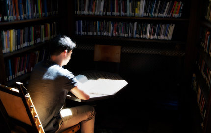 A student reads at the Hoose Library located in USC Dornsife's School of Philosophy. The School of Philosophy has jumped dramatically in the Philosophical Gourmet Report rankings. Photo by Dietmar Quistorf.