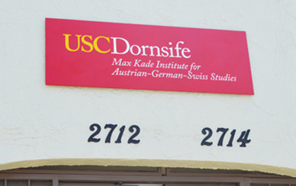 Housed in USC Dornsife, the sign for the Max Kade Institute for Austrian-German-Swiss Studies is proudly displayed over the entrance to the newly reopened institute. The building is located at 2714 South Hoover St., a few blocks from the USC University Park campus. Photo by Erica Christianson.