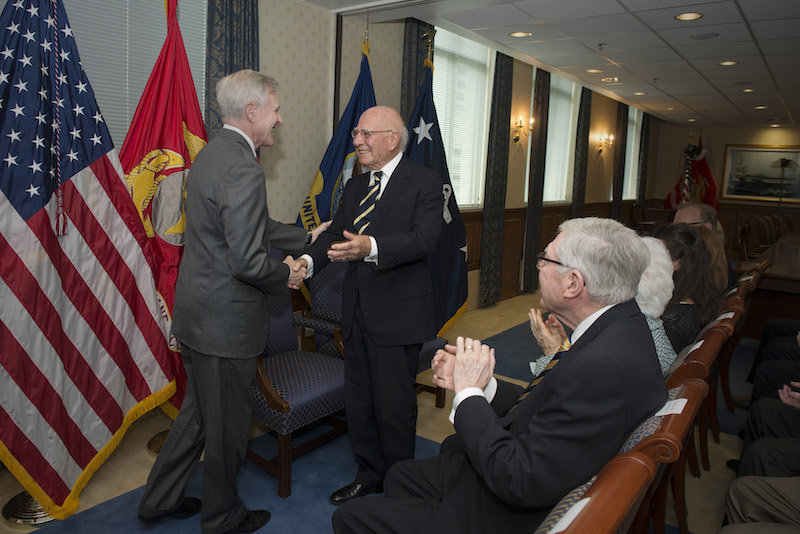 USC Dornsife alumnus Paul Ignatius (right) is congratulated by Secretary of the Navy Ray Mabus during the Washington, D.C., ceremony celebrating the naming of the future <em>USS Paul Ignatius</em>. U.S. Navy photo by Mass Communication Specialist 1st Class Arif Patani.