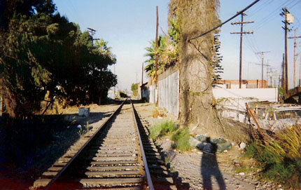 The 12-year-old inner-city child who took this photograph said it symbolized both a way out of life on the wrong side of the tracks and a life path choice between light and darkness. Photo courtesy of Elaine Kaplan.
