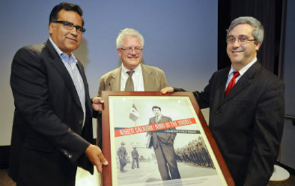 Filmmaker Phillip Rodriguez (left), USC Dornsife professor George Sanchez and Thomas Saenz, president of the Mexican American Legal Defense and Educational Fund, hold up a <em>Ruben Salazar: Man in the Middle</em> poster. Photo by Gus Ruelas.