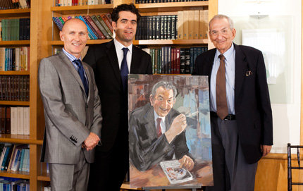 Nobel Laureate George Olah of USC Dornsife (right) receives a portrait of himself by the well-known Hungarian painter Kornél Zámbó from Hungarian Consul General László Kálmán of Los Angeles (left) and Ambassador Dán Károly, the consul general of the Hungarian consulate in New York. Photo by Janna Gould.