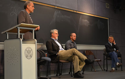 "Thomas Seifrid (standing, left), chair and professor of Slavic languages and literatures, moderated the Oct. 22 talk ""What's Up With Russia?"" Seated from left to right, Robert English, associate professor of international relations and director of USC Dornsife's School of International Relations, Brad Damaré, assistant professor of Slavic languages and literatures, and John Bowlt, professor of Slavic languages and literatures. Photos by Erica Christianson."