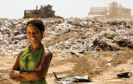 "Surveying the mountains of garbage surrounding her, alumna Julia McGinnis said, ""I see energy. I see money."" Photos by John Livzey."