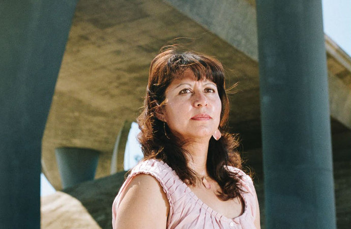 Maria Guzman helped PERE and other organizations collect air-quality data in the Pacoima, Calif., neighborhood, which is surrounded by freeways. Studies show that those living near air pollution sources have a higher risk of asthma, as her children experienced. They also risk cancer and respiratory illnesses. Photos by Damon Casarez.