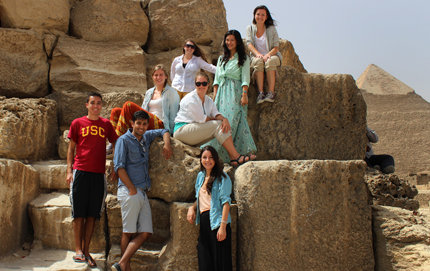 In Cairo, Egypt, USC Dornsife undergraduates studying religion and democracy braved temperatures of nearly 120 degrees Fahrenheit to visit the Great Pyramid of Giza. They are shown here at stone blocks of the pyramid's base. Photo by Steven Weier.