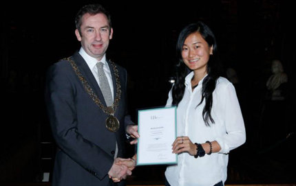 In a recent ceremony in Dublin, Ireland, Councillor Oisín Quinn, Lord Mayor of Dublin, presents USC Dornsife's Moeka Komachi with the Highly Commended Undergraduate Award for her paper recommending ways to improve education for dyslexic students in Hong Kong. Photo courtesy of the Undergraduate Awards.
