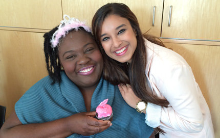 Surbhi Agarwal, a biological sciences minor at USC Dornsife (right), at a local homeless shelter, where she educates people about breast cancer and brings them goodies.
