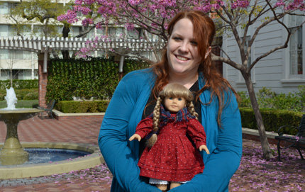 Senior Lucy Tew, holding her American Girl doll Kirsten, took the initiative and landed an internship with the international American Girl doll company, which informed her senior capstone project. Photo by Erica Christianson.