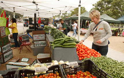 A patron enjoys the Farmer's Market, held Wednesdays from 11 a.m. to 3 p.m. at McCarthy Quad, at the University Park campus. Photo by Philip Channing.