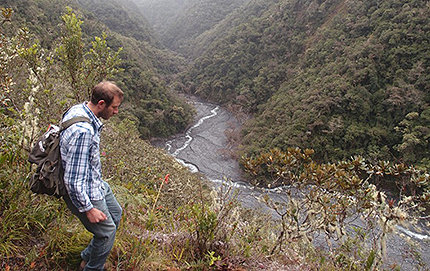 Researcher Josh West treks through a valley in Peru in search of evidence of chemical weathering of rocks as they erode. Photo by Mark Torres.
