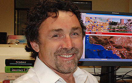 Spatial Sciences Institute Director John Wilson's 2014 University Consortium for Geographic Information Science (UCGIS) fellowship recognizes his extraordinary achievements in his field. Photo by Laurie Moore.