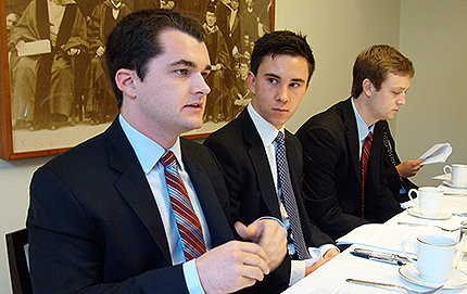 Members of USC's Value Investing Group (VIG) met with USC Dornsife alumnus Arthur Lev, a managing director at Morgan Stanley, to present investment pitches and get feedback. USC Dornsife sophomores Daniel Clancy (left) and Kes Rittenberg (center) help present the group's Dunkin' Donuts stock pitch to Lev. Photo by Laura Paisley.