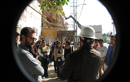 High school students in the Los Angeles Service Academy tour a construction site in Boyle Heights. Before the visit, Maria Cabildo, president of the East Los Angeles Community Corporation  and member of the Los Angeles City Planning Commission, spoke to them about a new housing development being constructed. Photo courtesy of William Deverell.