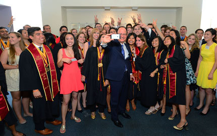 USC President C. L. Max Nikias takes a selfie with students honored at the 2014 Wall of Scholars ceremony at Leavey Library on May 10. Photo by Rich Schmitt.