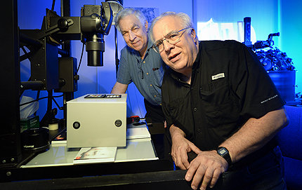 Bruce Zuckerman, front, his brother Kenneth and others at the USC West Semitic Research Project are pioneers in the use of digital photography for the preservation of ancient documents. Photo by Gus Ruelas.