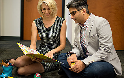 Henrike Moll (left) and Morteza Dehghani of psychology with books and toys they will use when they interview children for their study on how humans create alternative worlds to make decisions. Photo by Peter Zhaoyu Zhou.