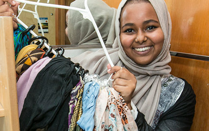 Freshman Newal Osman shows off her scarf collection. Photos by David Sprague.