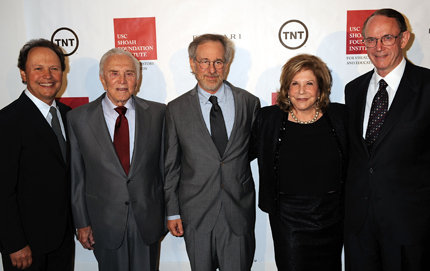 Host Billy Crystal; honoree Kirk Douglas; Steven Spielberg, founder of the Shoah Foundation, honorary chair of the Shoah Foundation Institute and USC trustee; Wallis Annenberg, USC trustee; and USC President Steven Sample attend the institute's 2008 annual Ambassadors for Humanity Gala held at the California Science Center. Photo by Jeff Kravitz/FilmMagic.com.