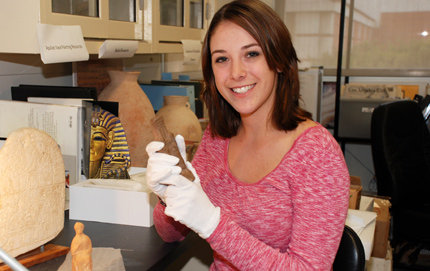 USC College senior Sarah Hawley studies figurines at the Archaeology Research Center. Photo credit Pamela J. Johnson.