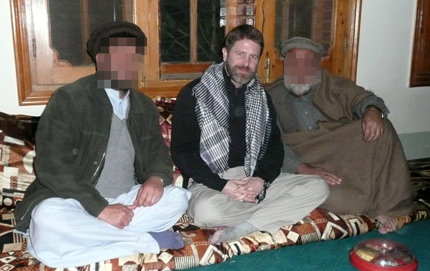 Embedded with a highly clandestine black operations team, Brad Thor '92 sits with two Afghans in a small village near Kabul. Researching his book, The Apostle, Thor visited scenes of horrific bombings and ambushes. Photo courtesy of Brad Thor.