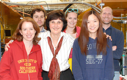 Winner of the Provost's Mentoring Award 2009, USC College's Hanna Reisler (center front) stands with her students and postdocs in her chemistry lab. From left, Laura Edwards and Lee Ch'ng. Back row from left, Mikhail Ryazanov, Blithe Casterline and Andrew Mollner. Photo credit Pamela J. Johnson.