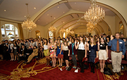 More than 150 juniors and seniors, mostly from USC College, take Phi Beta Kappa Society's official oath after receiving their certificates as new inductees. Photo credit Brian Morri.