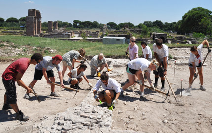 USC College professor John Pollini (back row, center) and a team of students excavate a site at the ancient Roman port town Ostia Antica.