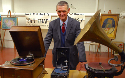 Institute of Modern Russian Culture Director John Bowlt stands next to a phonograph collection and original sound recordings of music and historic voices of Vladimir Lenin, Joseph Stalin and Leo Tolstoy. Bowlt has been awarded the Russian Federation Order of Friendship for his considerable contributions to disseminate Russian cultural accomplishments. Photo credit Taylor Foust.