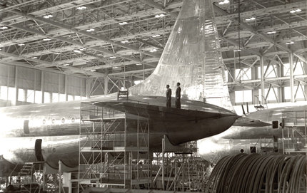 The tail section of the <em>Constitution</em>, an aircraft under construction at Lockheed Aircraft Co., Burbank in 1946. Because of the underpowered engines of the double-decker transport, Lockheed only built two planes before abandoning the model. Photo courtesy of the Harvey Christen collection, The Huntington Library, Art Collections, and Botanical Gardens.
