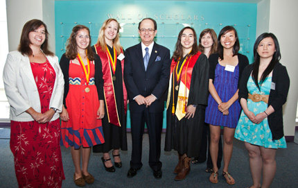 From left, Michelle Damian, Lyndsey Hoh, Emily Kamen, USC president C. L. Max Nikias, Cara Magnabosco, Amanda Tasse, Tiffany Yang and Debory Li. Photo by Noe Montes.
