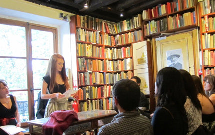 "USC Dornsife alumna Rosaleen O'Sullivan reads an original piece to the audience at the Shakespeare & Company bookstore on the final evening in the month-long Maymester course, ""The Poet in Paris."" Photo by Adrian Leeds."