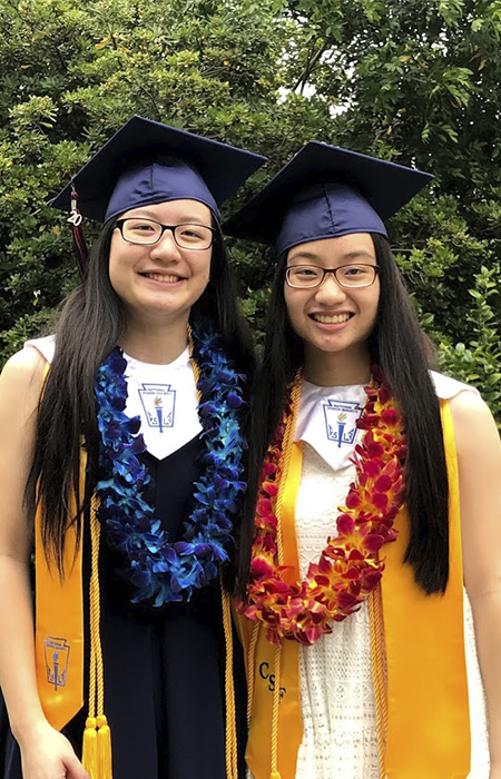 Samantha, left, and Sara Wu in their high school graduation regalia.`````